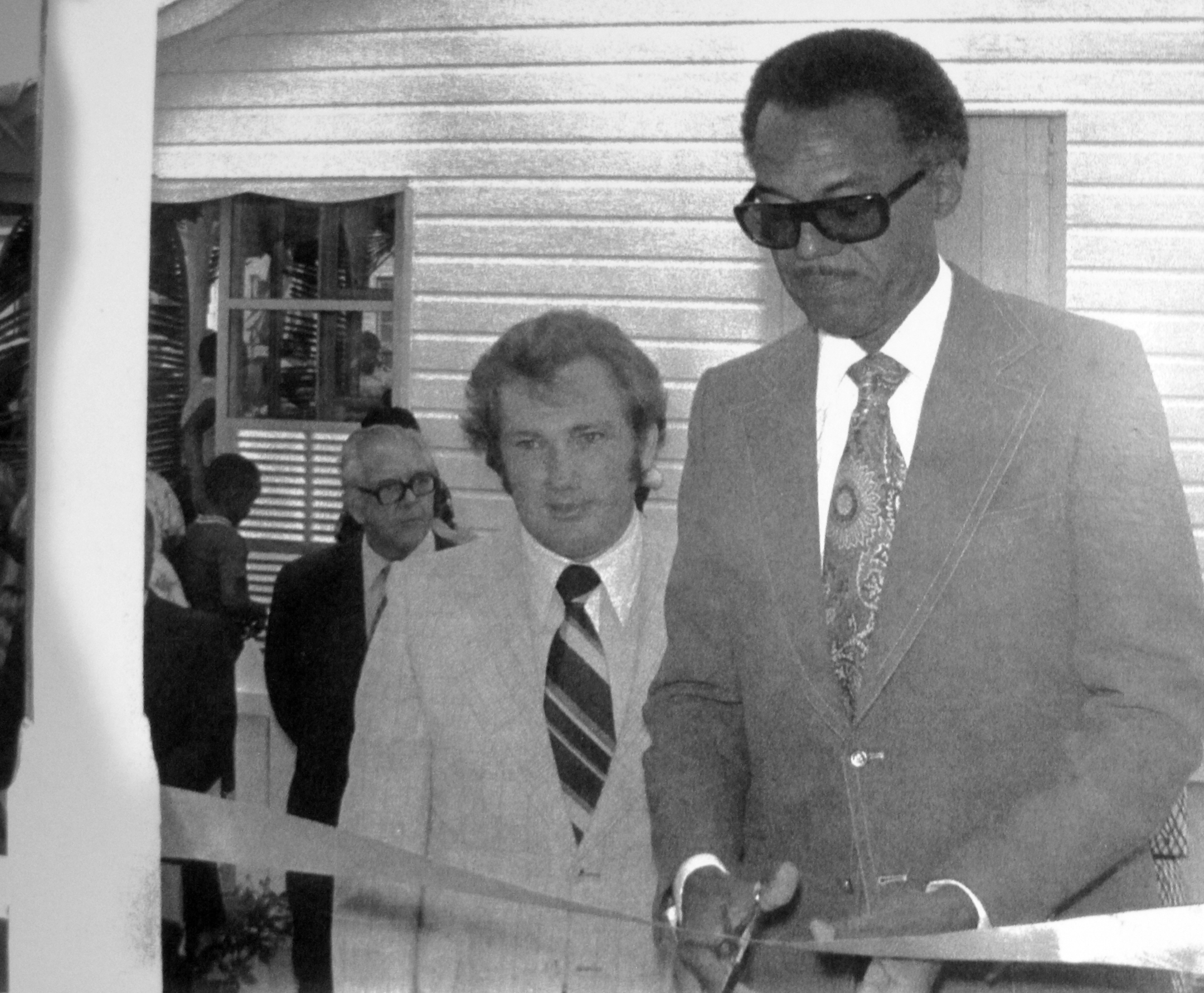 Sir Clement Maynard cuts the ribbon formally opening Green Turtle Cay's Albert Lowe Museum.